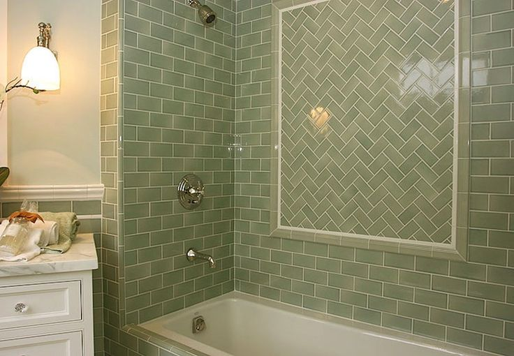 Want this for he kitchen!  green glazed porcelain tile with herringbone accent panel