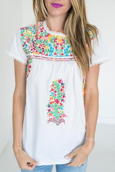 Colorfully & beautifully embroidered this top is instantly a favorite. It's bright, bold, and beautiful - just like the MMM girl. Features a hidden zipper in the back for ease. Light lace trim on neck
