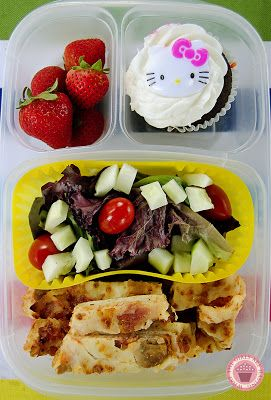 Leftovers for lunch! Leftover pizza, salad, strawberries and a Hello Kitty cupcake!