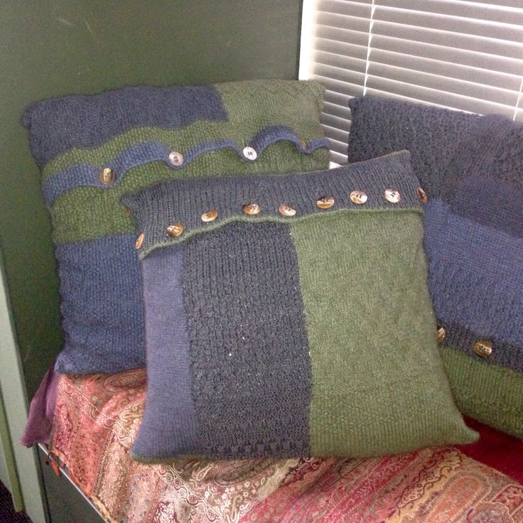 I hand knitted these three colour block cushions throw pillows buttoned covers out of NZ possum Merino in green, blues. I made it from sampler sections I knitted in various patterns. I pieced (joined / sewed using mattress stitch) and adds button closure.