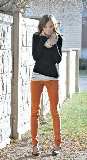 light orange skinny jeans, grey striped top under solid dark grey sweater. Here, I'd wear boots and add a scarf