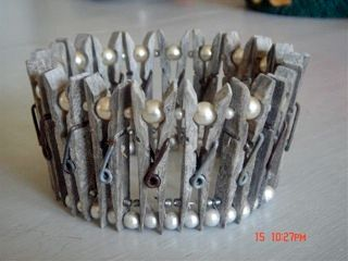 Patina'd wooden clothespins and white glass pearls makes an interesting wedding crown.