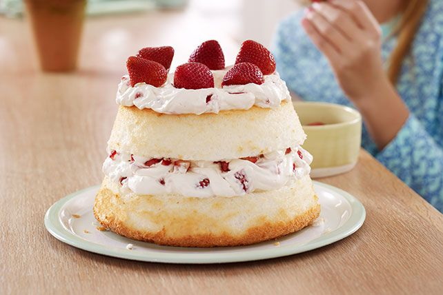 Layer juicy strawberries and luscious creamy filling in this airy Strawberry Angel Food Cake. Learn more about this refreshing summery dessert today!