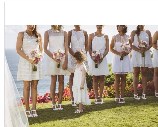Wall different white bridesmaids dresses in the same style and length