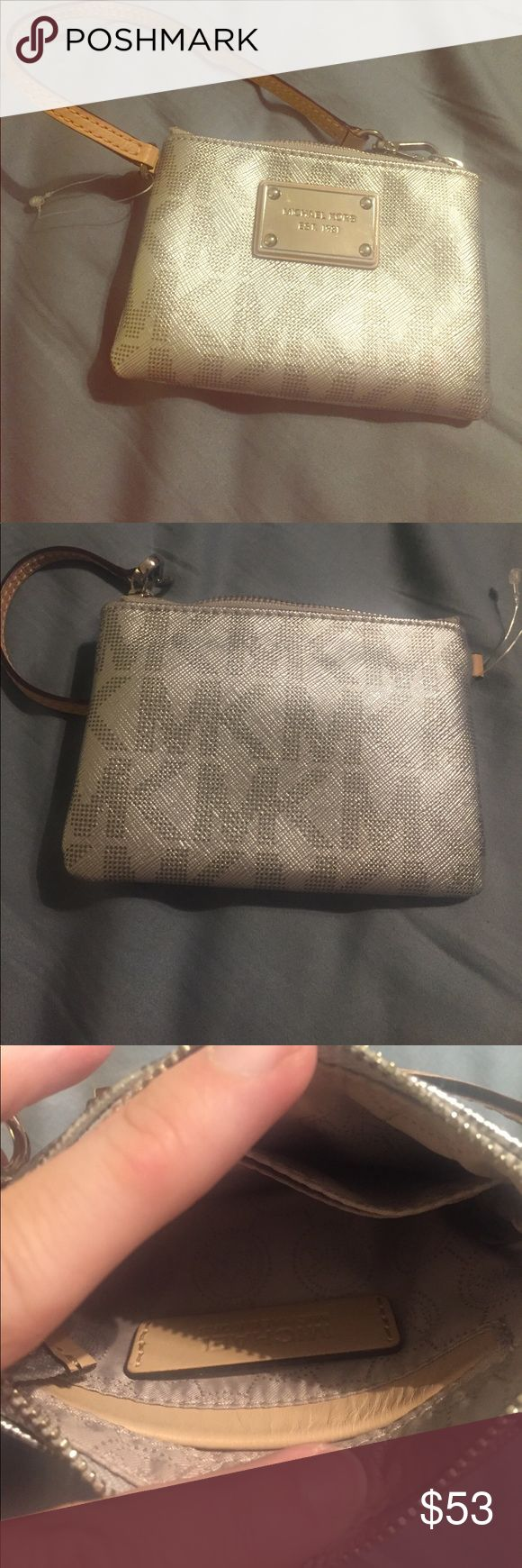 NWOT Michael Kors Coin Purse silver logo Got for Christmas gift and never used. NWOT Michael Kors Coin Purse silver logo Michael Kors Bags Clutches & Wristlets