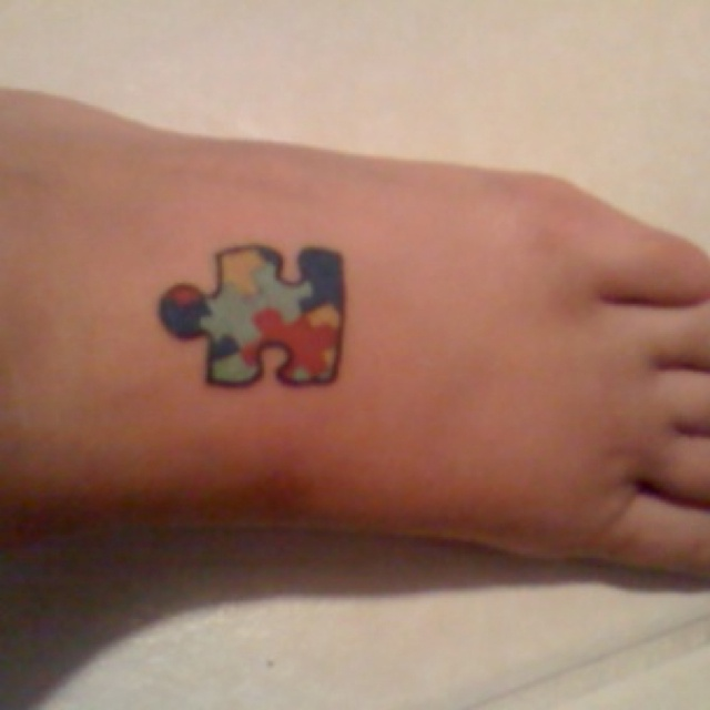 Autism puzzle piece tattoo for my 15 year old brother with Aspergers.