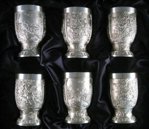 Eagle Pewter Cups 'Asian' - 6pc by Eagle. $222.00. The Eagle Pewter Asian Cups 6 pc set. These pewter cups are graced with 3 beautiful panels depicting nature scenes from a from a forest: Panel 1 - Panel 2 - Panel 3 . Same scenes as Ewer B-107, B108 4 1/2 in. tall x 2 7/8 in. rim Holds 8 ounces.