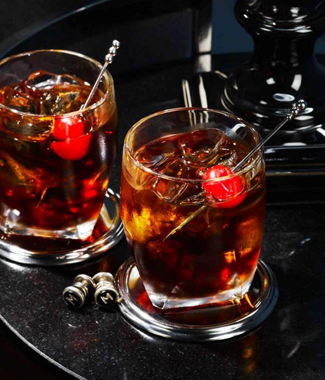Black Russian: 1.5 oz vodka, .75 oz kahlua, maraschino cherry