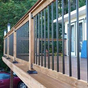 A happy customer of 1 Stop Home Solutions... pressure  treated deck with composite boards and black spindles. #kawarthalakes