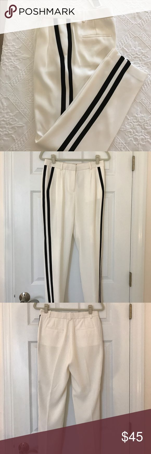 "JCrew Collection Tuxedo Pants in Size 2 These are a pair of JCrew cream colored pants with two black tuxedo stripes down the sides. They have a straight fit with a hint of drape and a straight leg. They have two front pockets and can be dressy or sporty. The inseam is 27"" and they are made of 100% polyester and lined. They are new with the tags. J. Crew Pants"