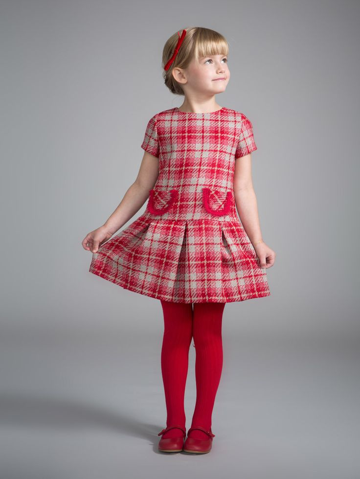 Ruby's Ladylike Plaid Outfit Girls' vermillion red tweed pleated dress with red trim pockets Designed by: Fina Ejerique Made in Spain