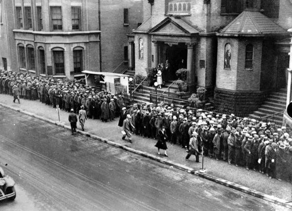 Unemployed line up in sub-zero weather at a city relief kitchen set up in NY 1/30/34 during the Great depression. 11 million were unemployed.
