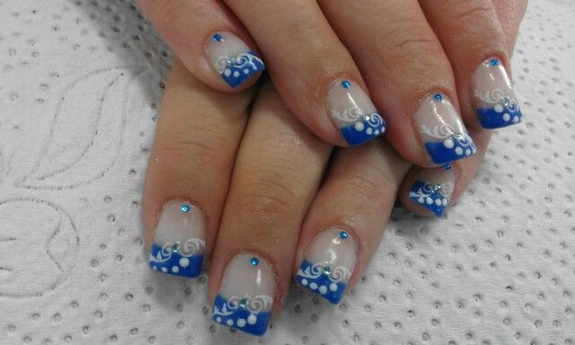 Blue French gel with white trible design & white dots finished off with light and dark blue diamontes