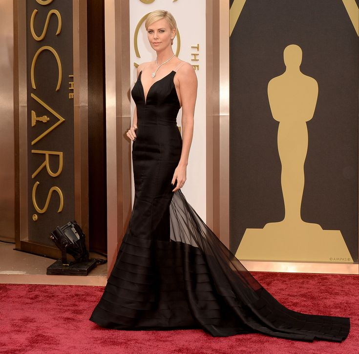 We fell hard for Charlize Theron's satin couture creation —and you did, too. So true!