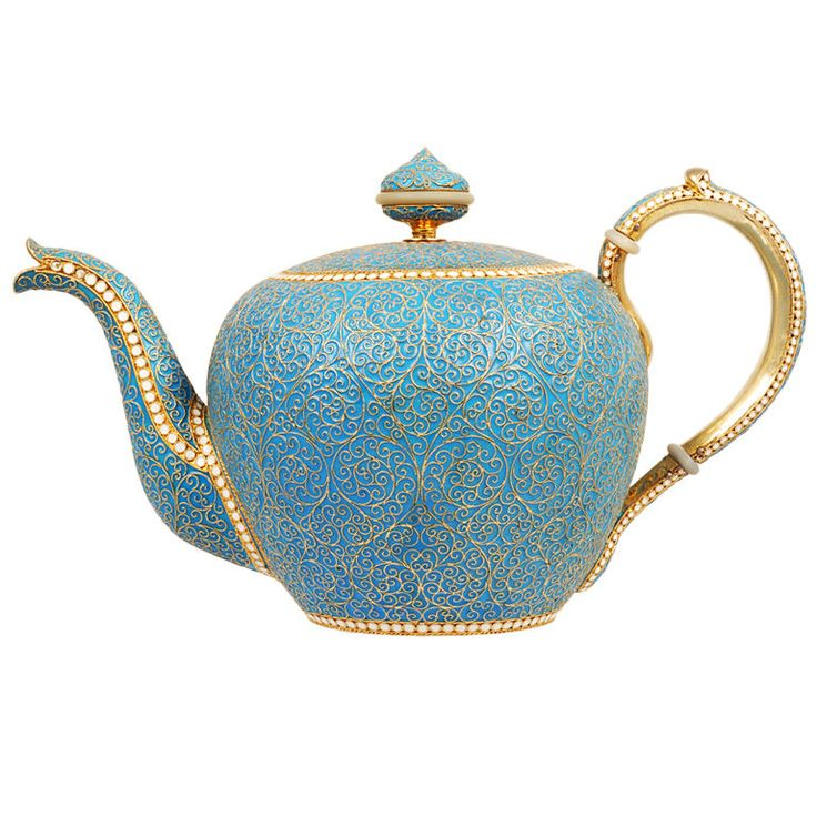 """A Russian silver gilt and cloisonne enamel teapot, Ivan Saltykov, Moscow, 1894. Of traditional form, the teapot, handle, spout, and separate lid completely covered in opaque turquoise enamel between twisted wire scroll designs and outlined with bands of white enamel beads. Height: 4 1/2""""."""