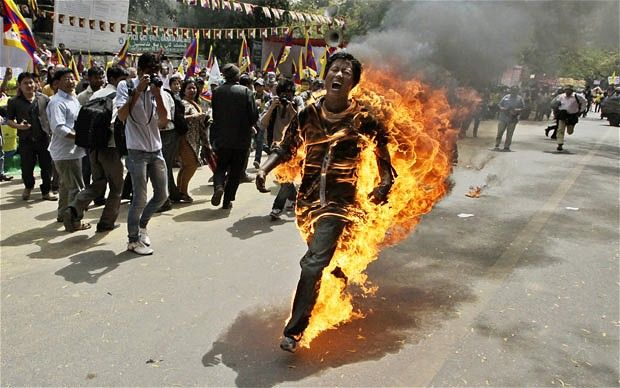 A Tibetan exile sets himself on fire during a protest against the forthcoming visit of Chinese President Hu Jintao to India  Photo: AP Photo/Manish Swarup