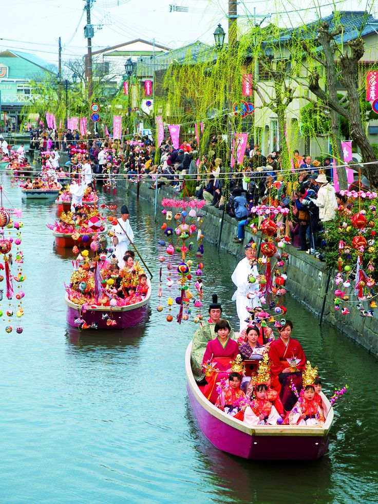 """""""Hina-matsuri"""" is a Japanese festival for girls in 3rd March. In Yanagawa, Fukuoka prefecture, people decorate with colorful dolls over the river and go toward up the stream in a boat. ...from this article of no.13 our issue. event management; Yanagawa city tourist association http://www.yanagawa-net.com/eng/midokoro.html"""