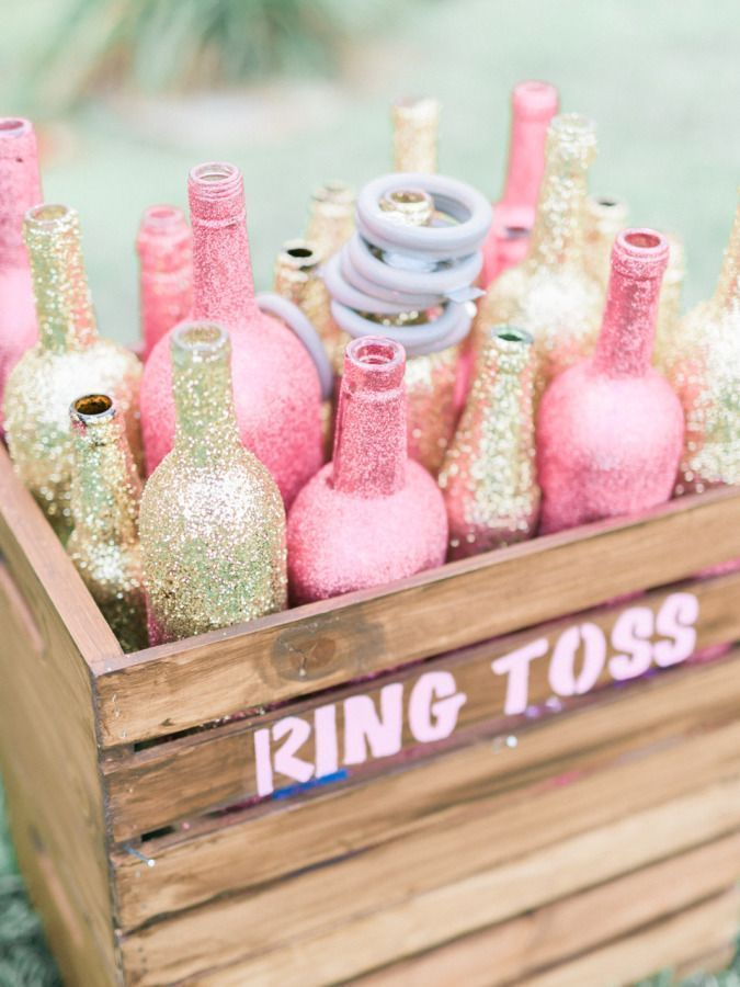 Such a cute idea for a fun baby shower game! Paint several glass bottles (wine bottles, pop bottles, etc.) to match your baby shower theme colors, by some rings at a craft store or toy shop, place bottles in a wooden bin, have guests throw the rings onto the bottles - the guest with the most ringers, wins a baby shower prize!