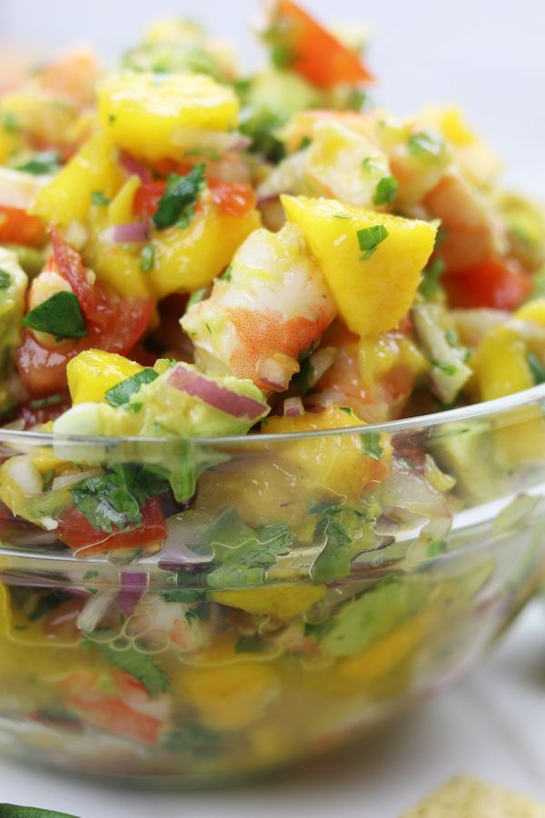 Refreshing and satisfying, Mango Shrimp Salsa is a fruity seafood feast that is perfect for parties or as a meal on hot summer nights.