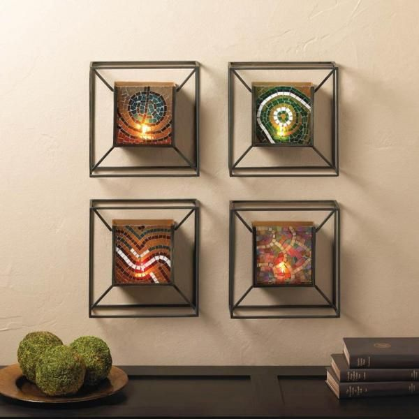 Light up your wall with this stunning mosaic glass and metal wall sconce. The square metal frame holds a mosaic glass tile with pretty colors that will shine br
