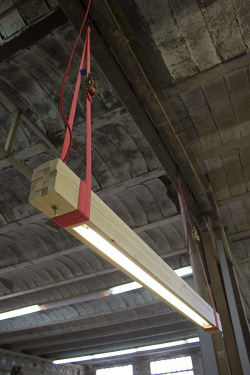 ROUGH Lamp came up from a package of wood strips forgotten in a corner of Ruth and Xavi's studio and a need: to light up their work desk !  The packaging tape that surrounded the strips became the straps which would make possible to hang them from the ceiling, having control of its height. OLI13 discovers ROUGH and cannot stop thinking about it. That's how this story begins... You could also check this other nice wood beam light