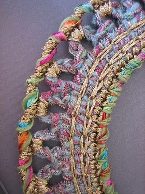 Dollybob: Crochet bijoux  This is a picture from Ravelry of an extraordinarily beautiful necklace.