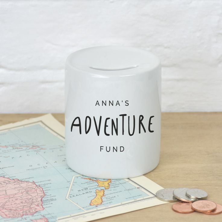 A personalised money box featuring your chosen name and the adventure you are saving for.