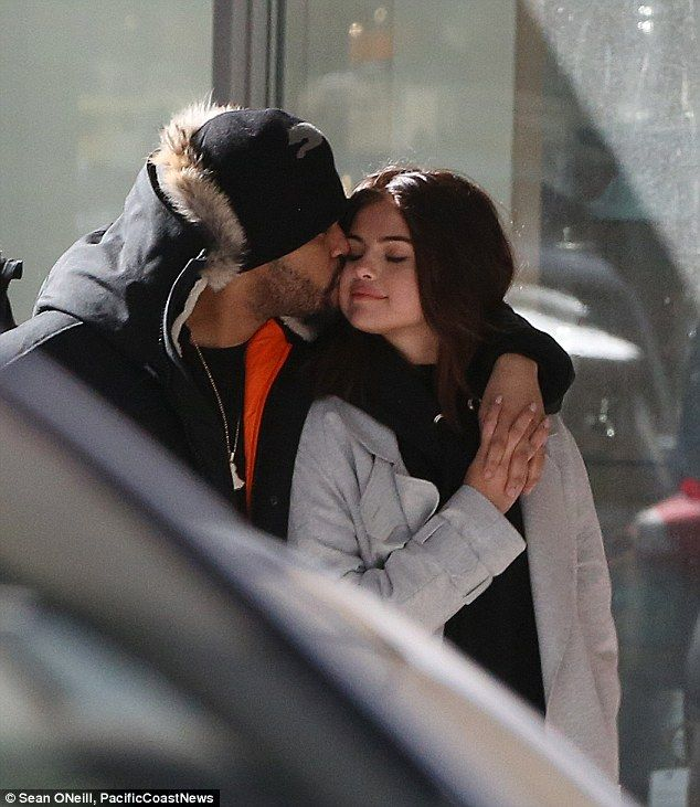 So in love... The Weeknd was seen tenderly planting a kiss on girlfriend Selena Gomez as they walked through Toronto together on Thursday