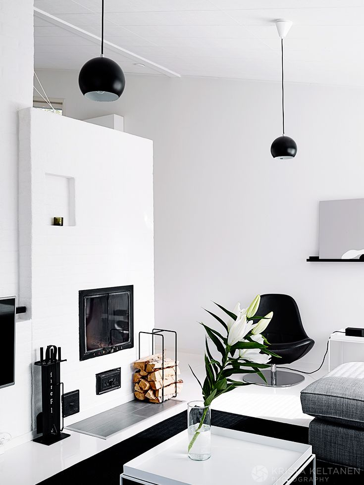black and white living room and fireplace