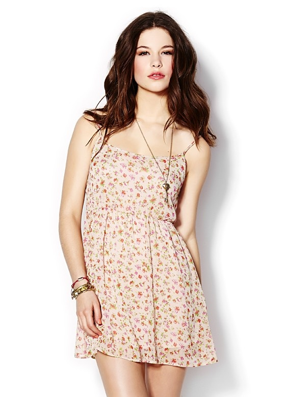 GARAGE Clothing Floral Chiffon Dress  Flirty florals. This floral chiffon dress is perfect to make your crush gush. It features thin ajustable straps, floral pattern, elastic waistline, flirty fit. Machine Wash. Imported 100% Polyester