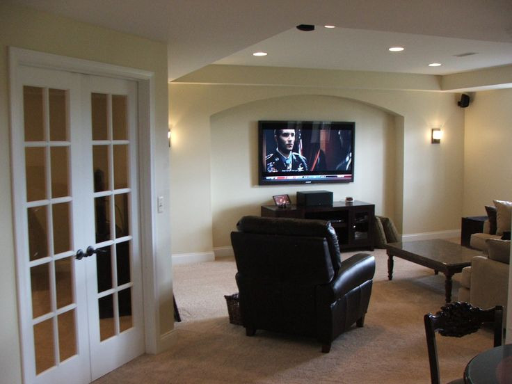 French double doors and a sweet arch over the home theater for Basement double door