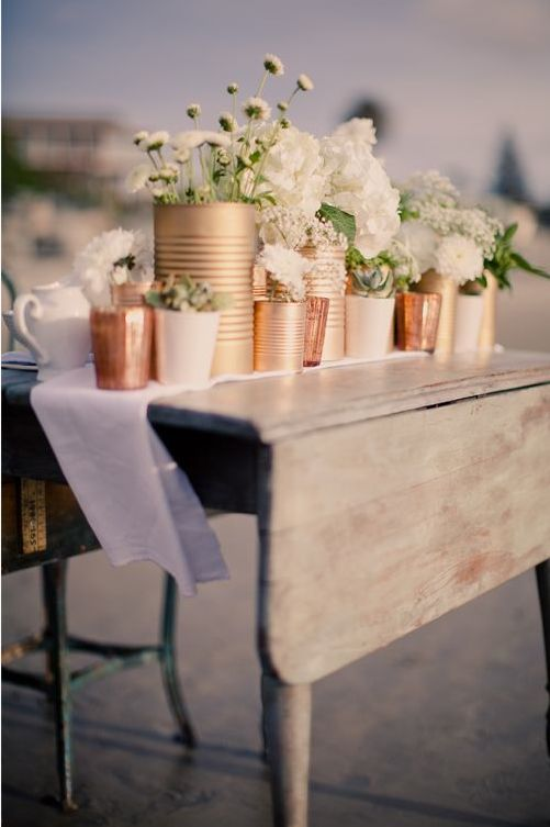 tin cans in copper, gold and blush tones. Decor for late night bbq on the deck?