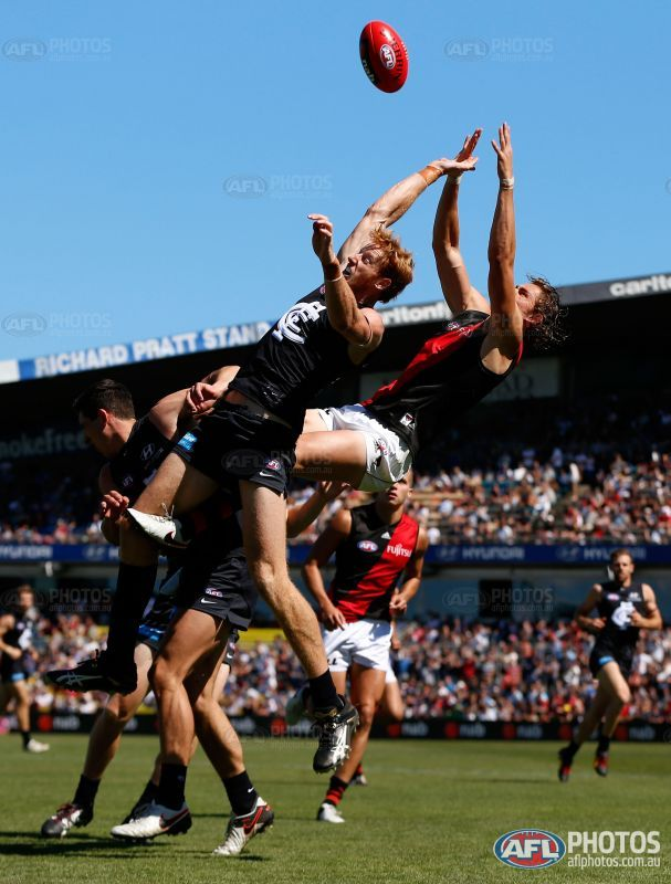 MELBOURNE, AUSTRALIA - FEBRUARY 28: Joe Daniher of the Bombers attempts to mark over Andrew Phillips of the Blues during the 2016 NAB Challenge match between the Carlton Blues and the Essendon Bombers at Ikon Park, Melbourne on February 28, 2016. (Photo by Adam Trafford/AFL Media)