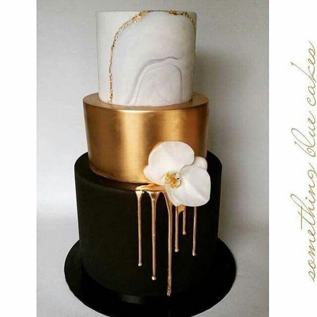 marble, gold and black drip modern wedding cake