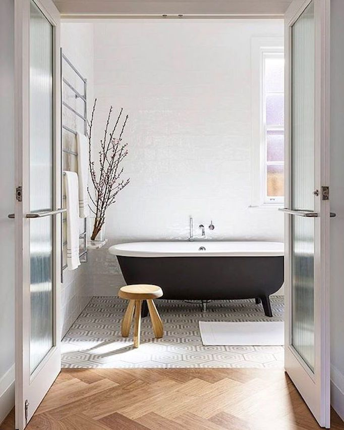 BECKI OWENS - Pinterest Top 10 - Visit the blog to see the top trending images on my boards this month! Like this warm minimalist bathroom with black claw foot tub.
