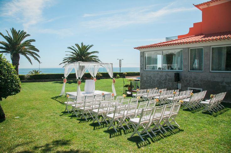 White Canopy and white wooden chairs - destination wedding celebration by the Sea #destinationweddingsinportigal #weddingceremonyportugal