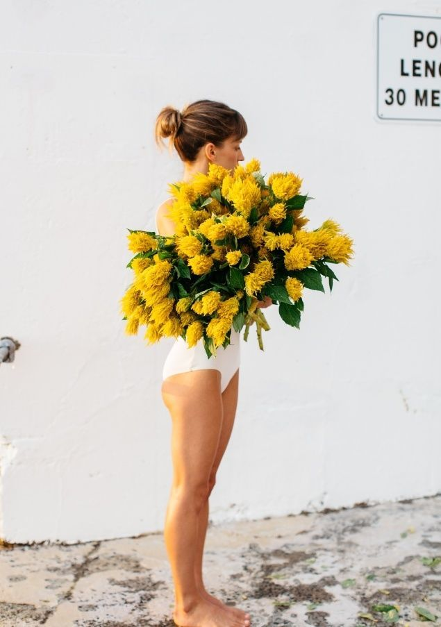 white one piece swim and yellow flowers