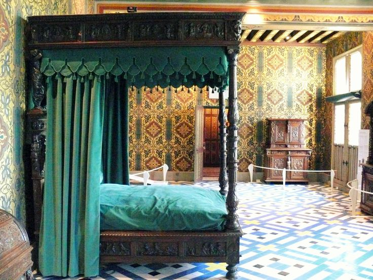 renaissance style interior featuring a grand four poster bed etched with detailed woodwork. Black Bedroom Furniture Sets. Home Design Ideas