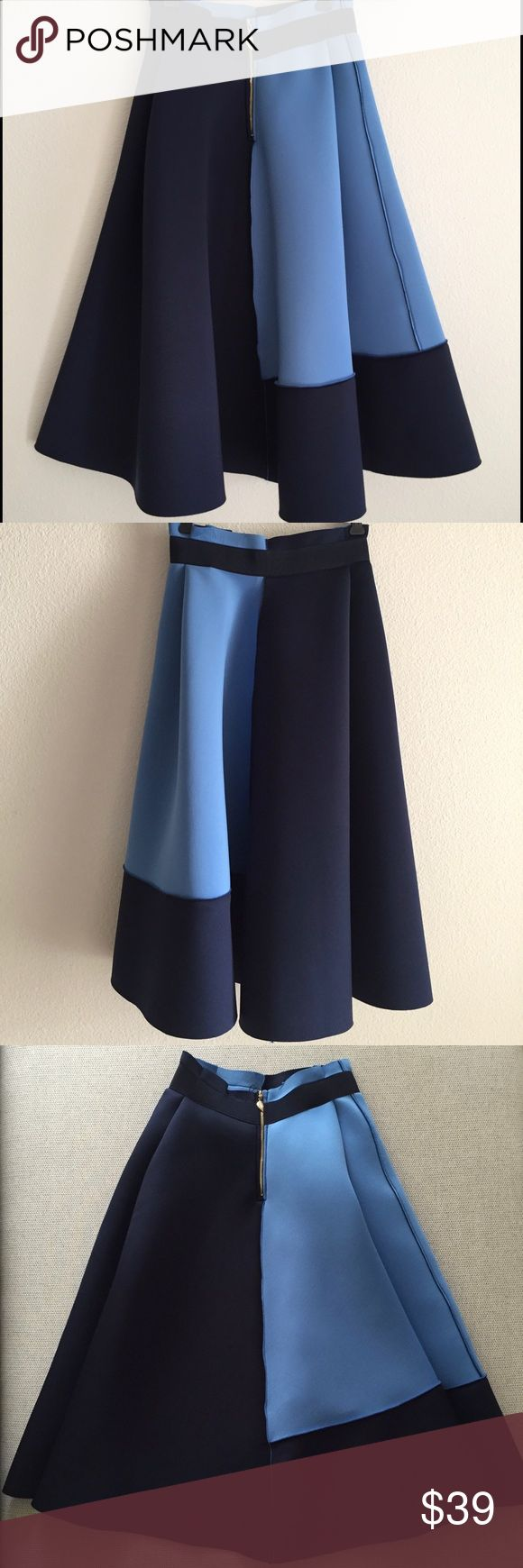 Glamorous Full Skirt This flowy skirt is great to pair up with just a white tank top, flats or pumps. Add a short Cardigan to complete the look. Fabric is a scuba-like thin material. Holds form well. Laid flat: Length 20 inches, tip to tip of the skirt is 54 inches, Waist is 24 inches. 95% Polyester, 5% Elastane. Glamorous Skirts Midi