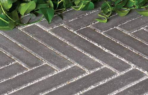 """Produced with a 1/16"""" bevel and a 4"""" thickness, Hanover's Permeable 3-1/4"""" x 18"""" is ADA Compliant. Minimal openings provide a comfortable walking surface while allowing for water percolation. Suggested for pedestrian use only."""