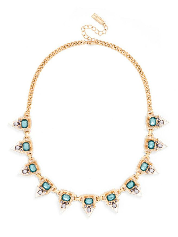 A classic geometric silhouette is embellished with a simple motif of colored jewels for a modern, graphic accent grounded in chic resin.