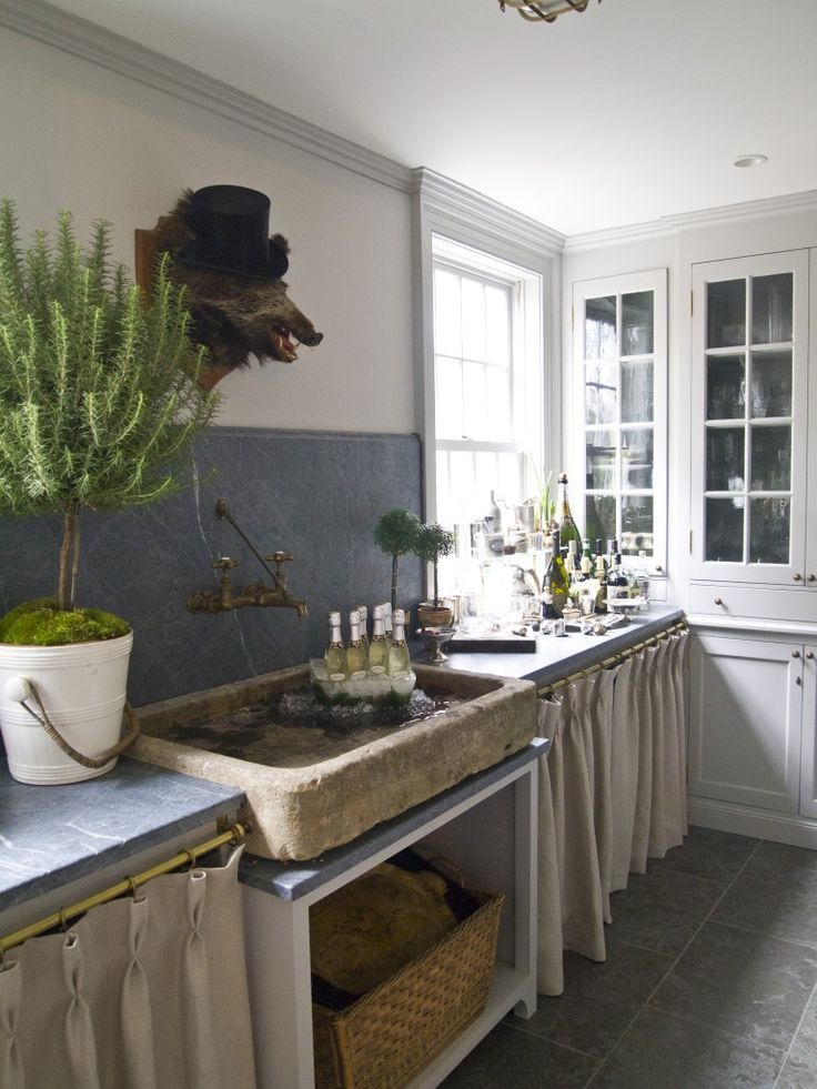 Jeannette Whitson's butler's pantry – with the stone sink she imports from Europe.  Soapstone counters and backsplash – and notice another gorgeous brass faucet with patina!!