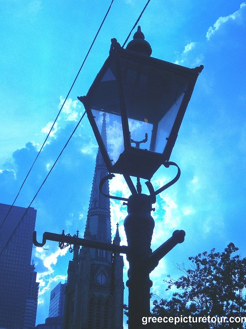 19th century lamp post in Toronto on King St - St James Cathedral spire in background