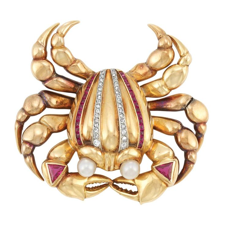 Gold, Diamond, Synthetic Ruby and Cultured Pearl Crab Clip  The polished gold crab's legs surmounted by 2 triangular-cut synthetic rubies, its body centering two slender rows of rose-cut diamonds, flanked by two rows of French-cut synthetic rubies, accented by 2 pearl eyes approximately 5.6 and 6.0 mm., circa 1940, approximately 26.3 dwts.