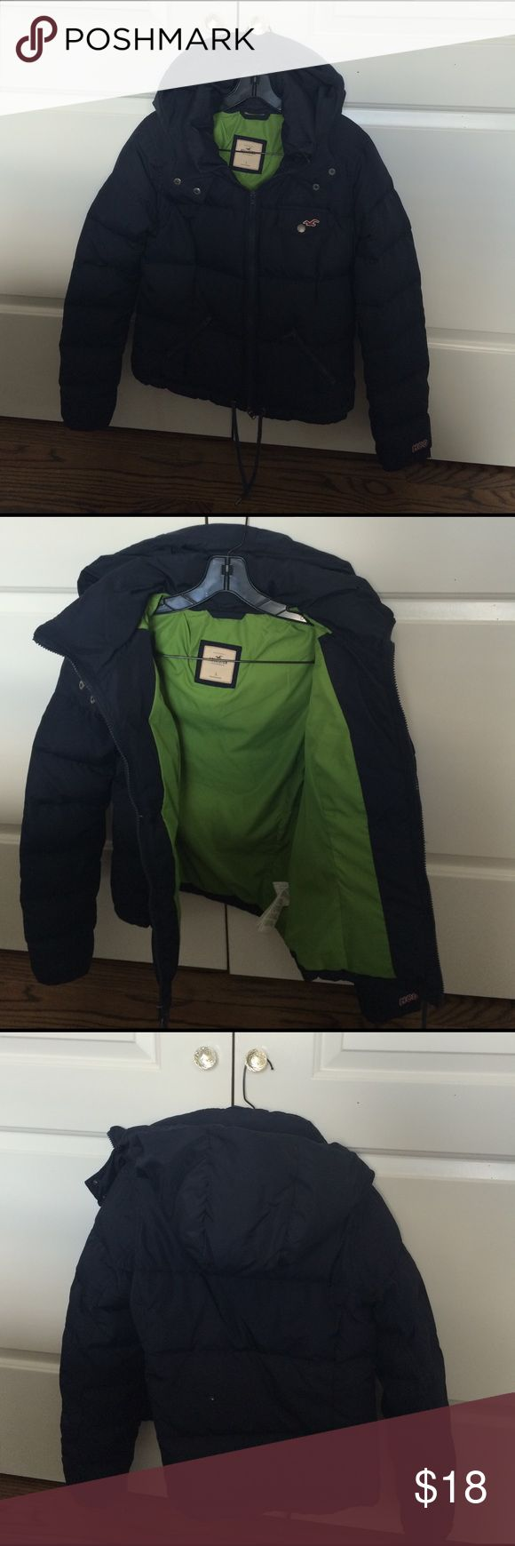 HOLLISTER coat Navy blue with green interior... Attached hood. Small hole on back as seen in photo but aside from that it's in good condition. Negotiable! Make an offer! Hollister Jackets & Coats Puffers