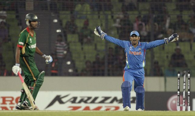 2011: Mahendra Singh Dhoni celebrates during the opening match of 2011 Cricket World Cup in Dhaka, Bangladesh.#IndiaDefends