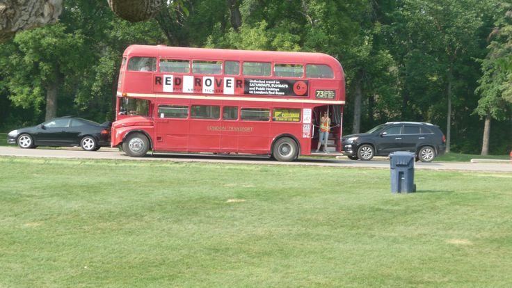 Shot of Doubledecker bus going through Assiboine Park Winnipeg Canada