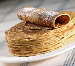 Pancakes traditionally eaten with syrup or sugar, often as dinner with a bowl of soup