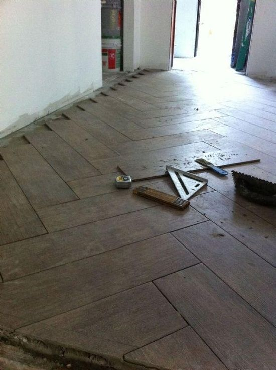 Herringbone Tile Design With Porcelain Tile That Looks Like Wood