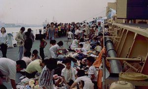 Safe haven: the rescued people look through donated clothing on the deck of the Wellpark.